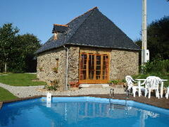 Property Photo: Garden cottage and swimming pool