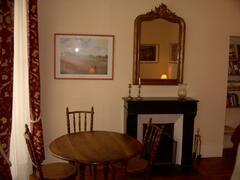 Property Photo: Fireplace and dining table
