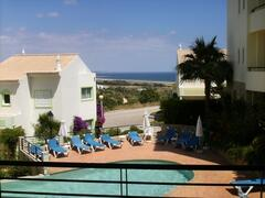 Property Photo: View from terrace overlooking adult swimming pool
