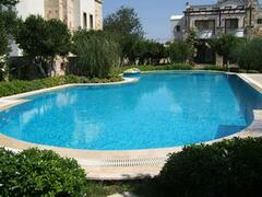 Property Photo: The lovely pool is just a few steps away