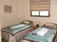 The 2nd bedroom also features twin beds to offer flexible sleeping arrangements