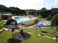 Vwith view to 2 pools - childrens pool has a waterfall