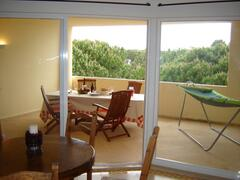 View to large secluded balcony and over flat top pine trees