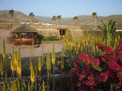 View of the house & thatched seabreeze dining area