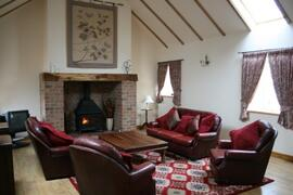 lounge with inglenook fireplace and log burner