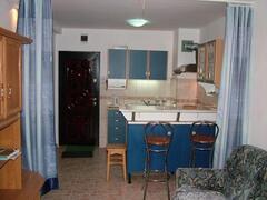 Property Photo: Kitchen and bar