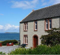 Property Photo: Gigha Apartment - West Coast of Scotland overlooking the Atlantic beside beach.