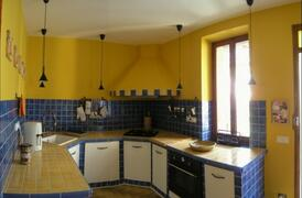 Well-equipped kitchen in Mediterranean style