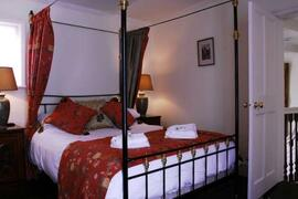 Property Photo: Bedroom with Four Poster