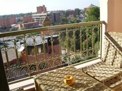 Balcony with open view on city and sunset