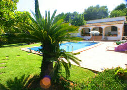 Property Photo: Pool terrace and garden