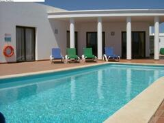 Property Photo: Pool and terrace area