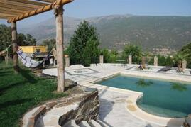 Property Photo: View of one of the cottages and swimming pool