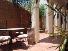 Property Photo: Dining area in the garden