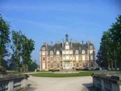 Property Photo: A view of the chateau & chestnut allee from the wrought-iron gates.