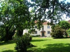 Property Photo: The main house from under the shade of the oak tree