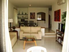 Property Photo: Living rooms opens out to garden/pool area