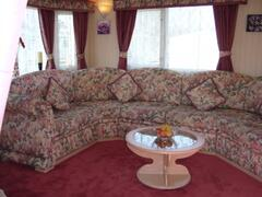Property Photo: This is the lounge area which seats upto 8 people, it also includes a pull out double sofa bed. The room over looks the dining and kitchen area and is very spacious through out