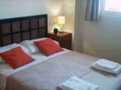 Bedroom 1, double bed, garden views, ensuite.