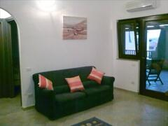 Comfortable lounge with sofa,pullout sofabed,TV/DVD,air conditioning unit.