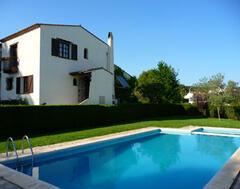 Property Photo: House with poolarea