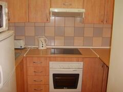 Property Photo: Kitchen with Halogen Hob, Microwave etc.