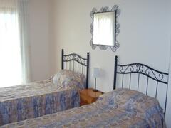 Twin Bedded Room with Double Doors to Balcony.