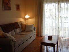 Lounge Area with Double Doors to Balcony.
