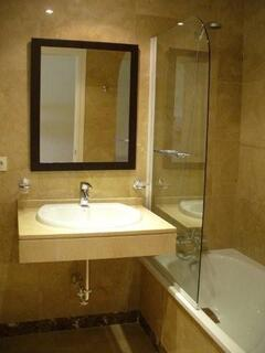 One of two bathrooms, marble throughout