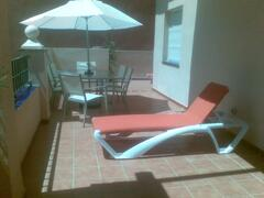 large L shaped Terrace HAS TWO SUNBEDS AND 6 SEATER