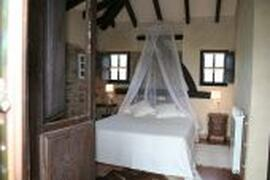Property Photo: Rustic bedroom
