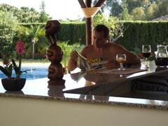Property Photo: Relaxing by the pool bar