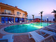 Property Photo: Sunset Beach Club - Evening Setting Over The Aegean Beach Pool