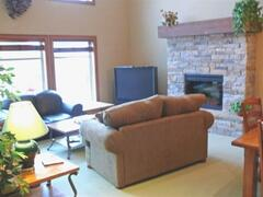Property Photo: Lounge area with big screen TV & gas fireplace