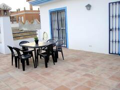 wide terrace on the top of the villa  with tables and chairs for 15 people and some sunbeds