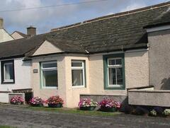 Property Photo: Mariner's Cottage, Allonby, on Cumbria's uncommecialized west coast is on the sea front