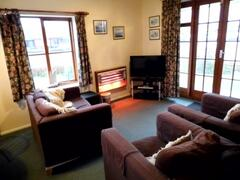 living room with cosy fire for winter fishing breaks