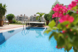 Property Photo: View across the pool towards the sea