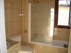 1 of 2 bathrooms both with bath and overhead shower