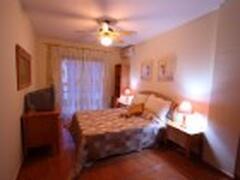 Spacious bedroom with doors onto balcony