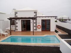 Property Photo: The Villa With the pool to the rear of the villa