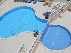 Property Photo: Aerial View of Double Level Infinity Pool