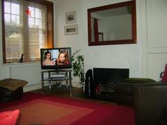 Log fire, large stripped wood windows, state of the art flatscreen TV/DVD/Sky+