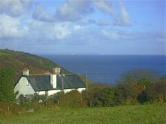 View of cottage from nearby fields, overlooking the sea towards Falmouth