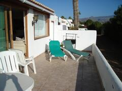 Terrace overlooking the golf course, bbq and sun loungers provided