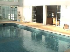 indoor pool and Patio Door,s to Living Room