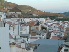 Views over the roof tops to the hills and sea