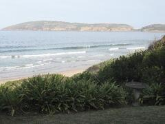 Property Photo: View from front garden of Robberg Reserve & Robberg Beach