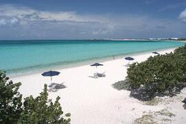 Enjoy crystal water and white sandy sand at the beach (20 seconds away)