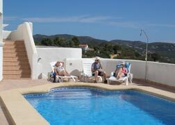Property Photo: Laze by the pool and enjoy the views